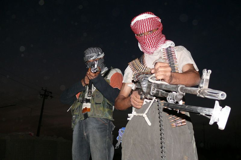 Iraqi_insurgents_with_guns_2006.0